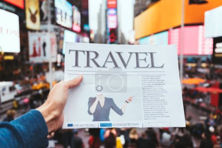Photo for Partial view of man holding business newspaper with blurry new york city street view on background - Royalty Free Image