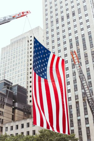 Photo for Close up view of american flag and buildings in new york city, usa - Royalty Free Image