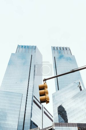 Photo for Low angle view of skyscrapers, traffic light and clear sky in new york city, usa - Royalty Free Image