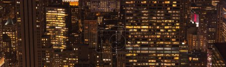 panoramic view of buildings and night city lights in new york, usa