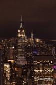 """Постер, картина, фотообои """"Аэрофотоснимок зданий и ночные огни города Нью-Йорк, США"""""""