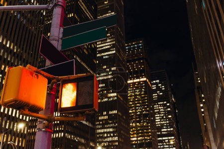 Photo for Close up view of new york traffic light and skyscrapers, usa - Royalty Free Image