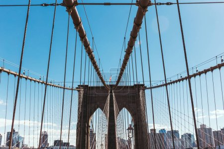 Photo for Brooklyn bridge on blue sky and manhattan on background, new york, usa - Royalty Free Image