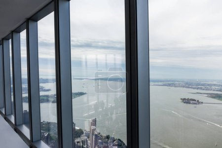Photo for View on cloudy sky and new york city through window, usa - Royalty Free Image