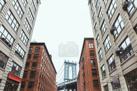 Photo for Urban scene with buildings and brooklyn bridge in new york city, usa - Royalty Free Image