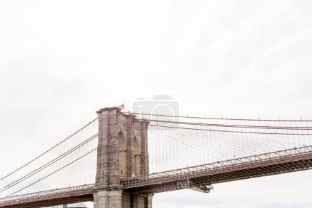 Photo for Low angle view of brooklyn bridge and cloudy sky on background, new york, usa - Royalty Free Image