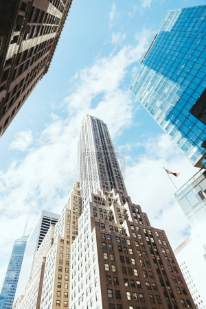 Photo for Low angle view of skyscrapers and cloudy sky in new york, usa - Royalty Free Image