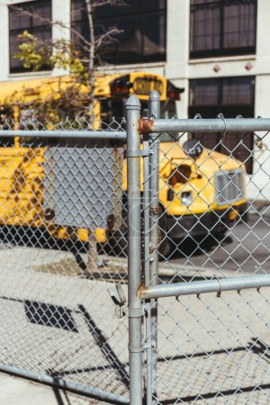 selective focus of net and school bus parked on street in new york, usa
