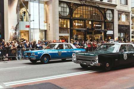 Photo for NEW YORK, USA - OCTOBER 8, 2018: city parade with police cars on street in new york, usa - Royalty Free Image