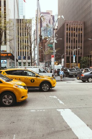 Photo for NEW YORK, USA - OCTOBER 8, 2018: urban scene with yellow cabs and people on new york city street, usa - Royalty Free Image
