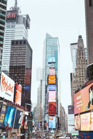 Photo for TIMES SQUARE, NEW YORK, USA - OCTOBER 8, 2018: skyscrapers and billboards on times square in new york, usa - Royalty Free Image