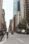 NEW YORK, USA - OCTOBER 8, 2018: urban scene with skyscrapers and city street in new york, usa