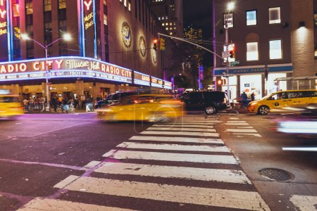 Photo for TIMES SQUARE, NEW YORK, USA - OCTOBER 8, 2018: motion picture of times square and cars in new york at night, usa - Royalty Free Image