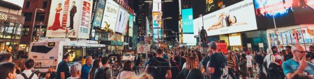Photo for TIMES SQUARE, NEW YORK, USA - OCTOBER 8, 2018: panoramic view of crowded times square in new york at night, usa - Royalty Free Image