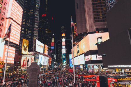 Photo for TIMES SQUARE, NEW YORK, USA - OCTOBER 8, 2018: urban scene with crowded times square in new york at night, usa - Royalty Free Image
