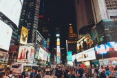 TIMES SQUARE, NEW YORK, USA - OCTOBER 8, 2018: urban scene with crowded times square in new york at night, usa