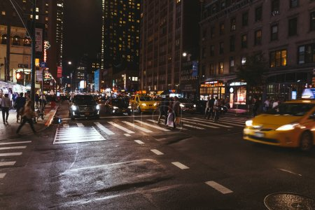 Photo for NEW YORK, USA - OCTOBER 8, 2018: urban scene with new york city street at night, usa - Royalty Free Image