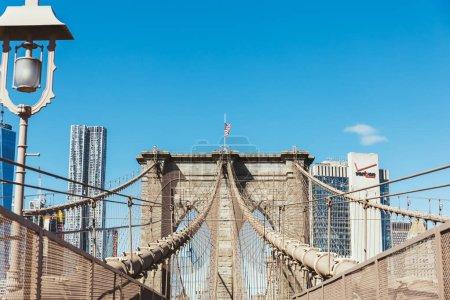 BROOKLYN BRIDGE, NEW YORK, USA - OCTOBER 8, 2018: beautiful view of brooklyn bridge on blue sky background, new york, usa