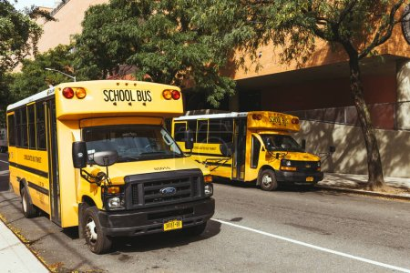 NEW YORK, USA - OCTOBER 8, 2018: yellow school buses parked on street, new york, usa