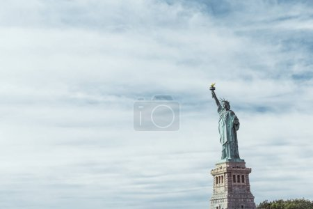 Photo for STATUE OF LIBERTY, NEW YORK, USA - OCTOBER 8, 2018: statue of liberty in new york against blue cloudy sky background, usa - Royalty Free Image