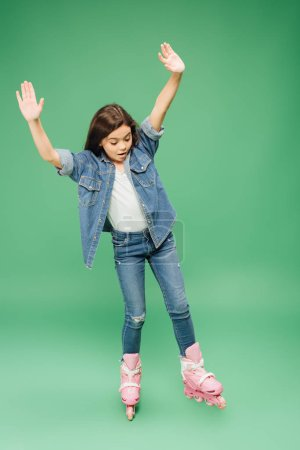 child rollerblading with outstretched hands on green background