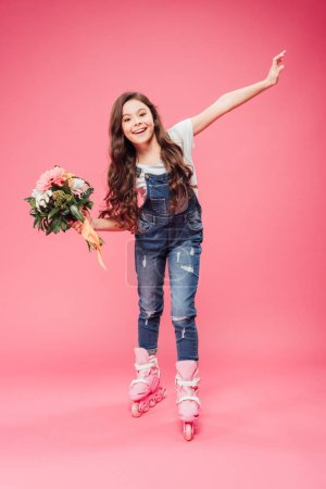 cheerful child in rollerblades with flower bouquet on pink background