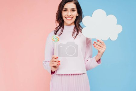 Photo for Beautiful woman holding candy and speech bubble on blue and pink background - Royalty Free Image