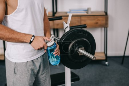 Photo for Cropped view of man holding sport bottle - Royalty Free Image