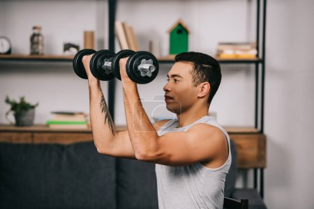 Photo for Strong mixed race sportsman workout with heavy dumbbells - Royalty Free Image