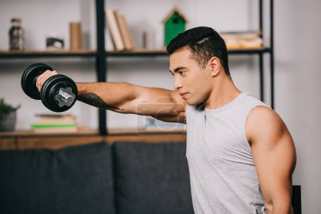 strong mixed race sportsman workout with heavy dumbbell
