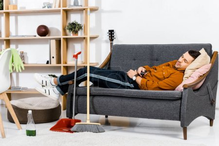 handsome man sleeping on sofa in modern living room