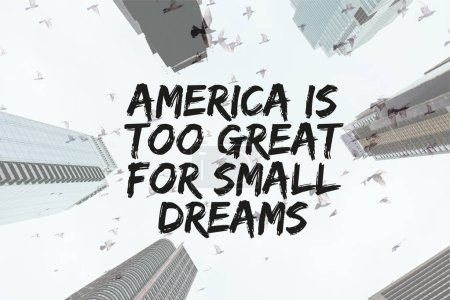 """Photo for Bottom view of skyscrapers and clear sky with birds and """"america is too great for small dreams"""" quote in new york city, usa - Royalty Free Image"""