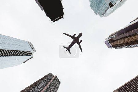 Photo for Bottom view of skyscrapers and clear sky with airplane in new york city, usa - Royalty Free Image