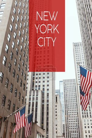 "low angle view of skyscrapers and american flags on new york city street with ""new york city"" lettering, usa"