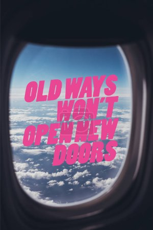 """view of blue cloudy sky from airplane with """"old ways wont open new doors"""" quote on window"""