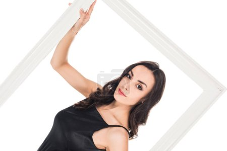 beautiful woman in black dress posing with frame isolated on white