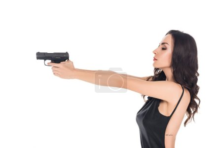 beautiful female killer aiming with gun isolated on white