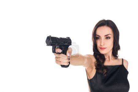 beautiful elegant killer aiming with handgun isolated on white