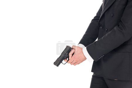 partial view of killer in black jacket holding gun, isolated on white