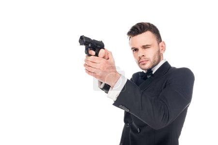 dangerous killer in black suit aiming with gun, isolated on white