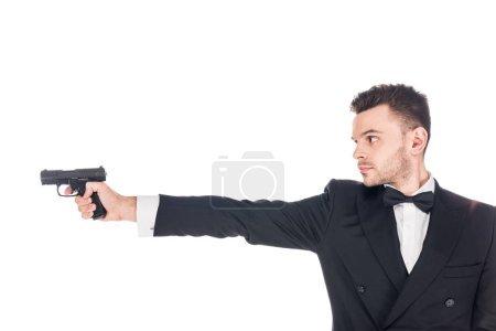 dangerous secret agent in black suit aiming with gun, isolated on white