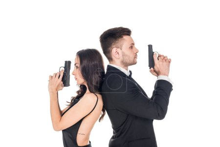 attractive couple of secret agents in black clothes posing with weapon, isolated on white