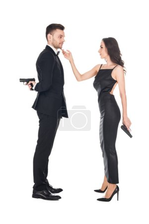 together couple of killers in black clothes holding guns, isolated on white