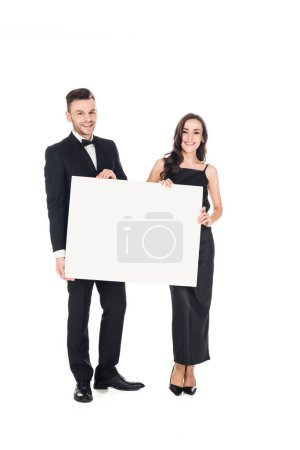 beautiful elegant couple in black clothes holding blank board, isolated on white