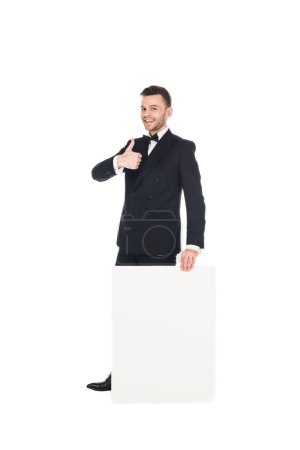 handsome elegant man with blank placard showing thumb up isolated on white