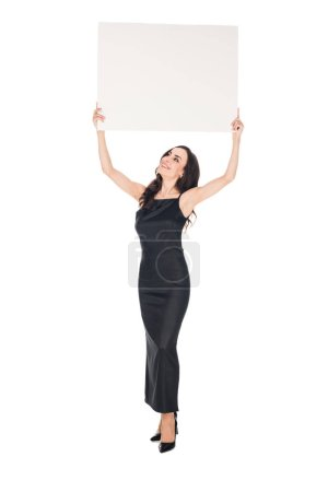 elegant woman in black dress posing with blank placard isolated on white