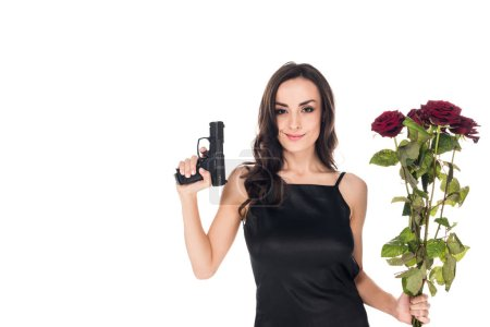 beautiful smiling secret agent holding handgun and red roses, isolated on white