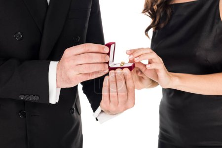 Photo for Cropped view of boyfriend holding proposal ring in box for girlfriend, isolated on white - Royalty Free Image