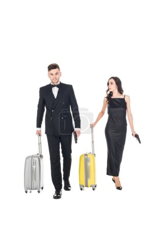 couple of killers in black clothes with guns and travel bags, isolated on white