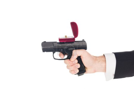 Photo for Cropped view of man holding gun with proposal ring, isolated on white - Royalty Free Image